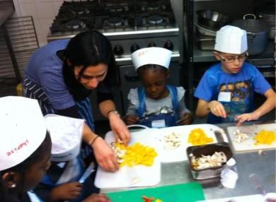 Cecilia Teaching Children to Cook